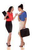 As mulheres de negócio… e seu dedo estão acima Foto de Stock