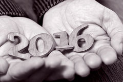 2016, as the new year, in the hands of a man, duotone Royalty Free Stock Photo