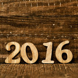 2016, as the new year. Wooden numbers forming the number 2016, as the new year, on a rustic wooden surface royalty free stock photo
