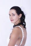 As noivas bonitas vestem o vestido de casamento floral branco Fotografia de Stock Royalty Free