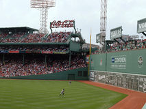As outfields chase down a fly ball at Fenway Royalty Free Stock Image