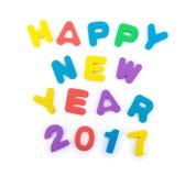 As palavras do ano novo feliz 2017 deram forma pelo enigma de serra de vaivém do alfabeto Imagens de Stock Royalty Free