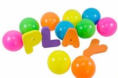 As palavras JOGO com as bolas coloridas no branco Fotos de Stock Royalty Free