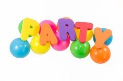 As palavras PARTY com as bolas coloridas no branco Foto de Stock Royalty Free