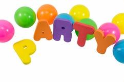 As palavras PARTY com as bolas coloridas no branco Fotografia de Stock Royalty Free