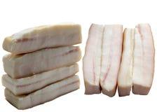 As partes de gordura bruta da carne de porco são isoladas em um fundo branco Fotografia de Stock
