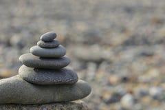As pedras da praia repetidamente Imagens de Stock