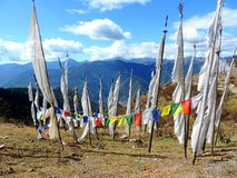 White flags as per Bhutanese customs. As per the Bhutanese tradition, white flags are hoisted in the memory of the dead family members so that their souls rest Royalty Free Stock Photos