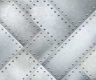 As placas de metal giraram 45 graus com rebites fundo ou textura Fotos de Stock