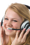 As it is pleasant to listen to. The nice blonde works as the operator Royalty Free Stock Image
