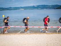 As Pontes - Spain Athletes carring tires during the Samurai Xtreme Race 2018 stock image