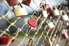As a promise of love, the lovers close padlocks along the bridge. S Royalty Free Stock Photo