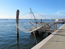 As redes de pesca penduraram na ilha de Pellestrina, Veneza Imagens de Stock