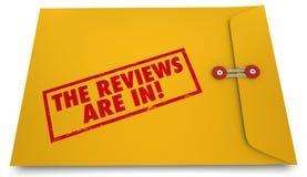 As revisões estão no envelope do feedback Fotos de Stock Royalty Free