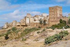 As rochas vermelhas e as casas velhas decoradas de Kawkaban fortificaram a cidade Fotos de Stock