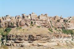 As rochas vermelhas e as casas velhas decoradas de Kawkaban fortificaram a cidade Imagem de Stock