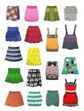 As saias e os sundresses das crianças Fotografia de Stock