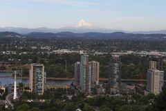 A view of Mount Hood from Portland, Oregon. As seen from the top of a hill, at a sky tram station overlooking the city and the Willamette River, on a summer day royalty free stock photo