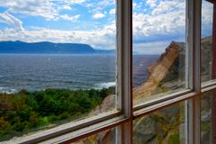 As Seen Through A Window, Lobster Cove Head Lighthouse, Newfoundland, Canada. Ocean and Tablelands as seen through a Window at Lobster Cove Head Lighthouse stock images