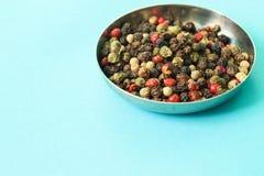 As sementes da pimenta da cor misturam foto de stock