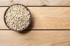 As sementes do painço podem dentro foto de stock royalty free