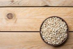 As sementes do painço podem dentro fotografia de stock royalty free