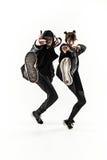 As silhuetas do homem de dois hip-hop e dos dançarinos fêmeas da ruptura que dançam no fundo branco Imagens de Stock