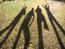 As sombras dos amigos Fotos de Stock