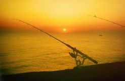 Fishing Poles at a Pier in Myrtle Beach during Sunrise Stock Photography