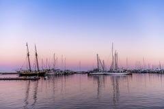 Sailboats in bay at sunset royalty free stock photography