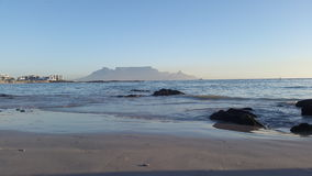 As the sun goes down and the light beams forth towards table Mountain Royalty Free Stock Photo