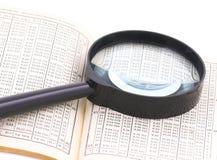 As tabelas e os números ampliam Imagens de Stock