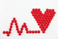 As tabuletas do coração do vermelho Imagens de Stock
