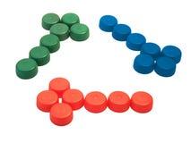 As tampas plásticas como recicl o símbolo Fotografia de Stock Royalty Free