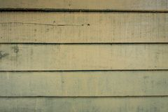 As texturas do fundo ou os papéis de parede de madeira velhos colocaram o horizontal e claro - verde pintado no estilo retro foto de stock