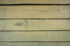 As texturas do fundo ou os pap?is de parede de madeira velhos colocaram o horizontal e claro - verde pintado no estilo retro imagem de stock