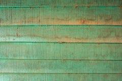 As texturas do fundo ou os pap?is de parede de madeira velhos colocaram o horizontal e claro - verde pintado no estilo retro imagens de stock