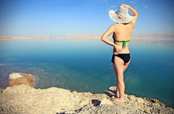 As warm here. Girl sunbathing on the beach with warm summer day Stock Photos
