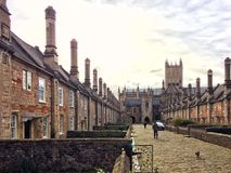 As it was, in. Tall chimneys and cobbled streets in Vicars Close near the cathedral in Wells Royalty Free Stock Images