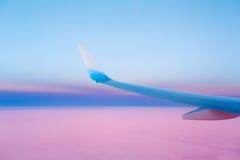 Asa de um avião no por do sol Foto de Stock