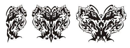 A asa tribal da borboleta formou pela cabeça do leão e pela cabeça da águia Fotos de Stock Royalty Free