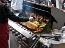 Asado a la parilla de la carne con la materia de la barbacoa Imagen de archivo