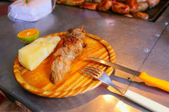 Asado meal on a cutting board at street stall in Asuncion, Parag Royalty Free Stock Photography