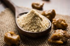 Stock Photo of Asafoetida powder / Hing or Heeng with cake and mortar Royalty Free Stock Images