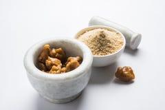 Stock Photo of Asafoetida powder / Hing or Heeng with cake and mortar Stock Image