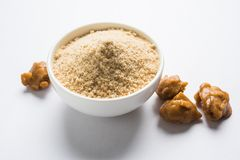 Stock Photo of Asafoetida powder / Hing or Heeng with cake and mortar. Asafoetida cake and powder or Hing or Heeng which is an important ingredient in Indian stock photo