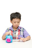Asain boy counting coins from piggybank. Isolated on white Royalty Free Stock Photos