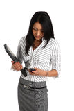 Asain business woman. Young asain business woman holding a laptop and using a mobile phone Royalty Free Stock Images