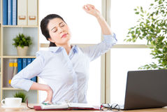 Asain businesswoman fell tired and stretching stock photo