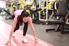 Asain chinese smiling people Woman ready for running in the gym. Sports, power. Fitness, sport, training, gym and lifestyle concept -  smiling woman Fitness Royalty Free Stock Images